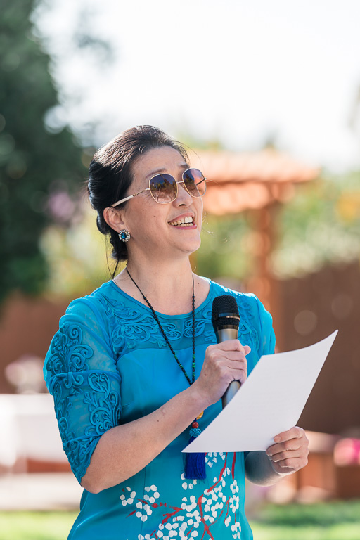 mother of the groom giving speech during backyard ceremony