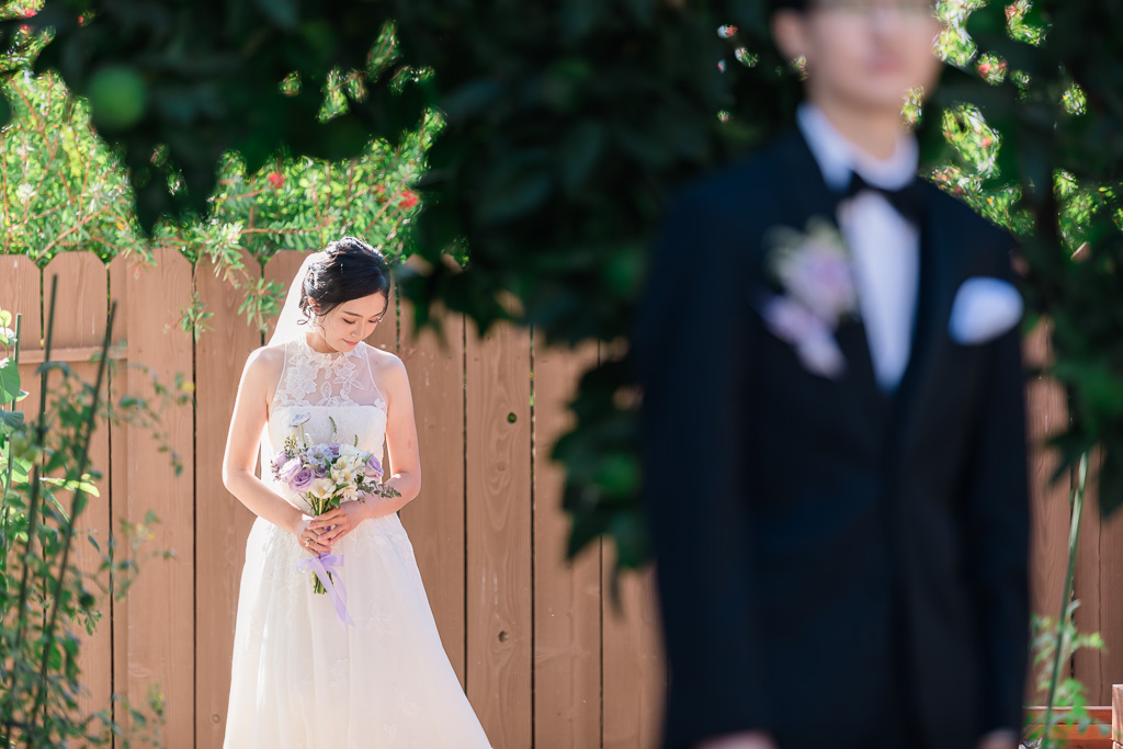 bride walking up to groom during first look