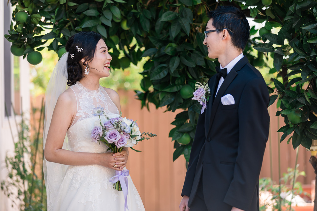 bride and groom looking at each other during first look