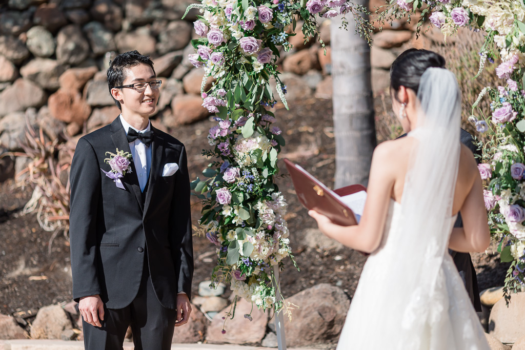 bride reading wedding vows out of a binder