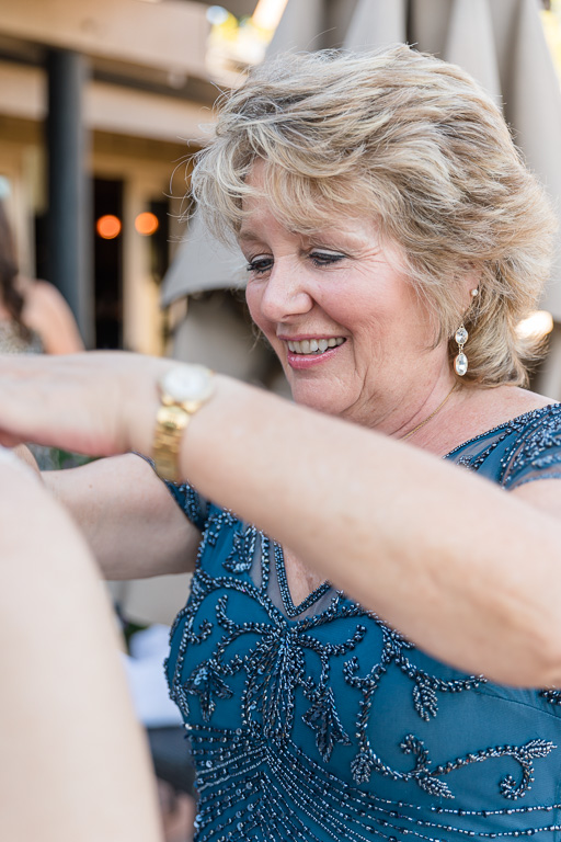 mother of the bride helping with dress