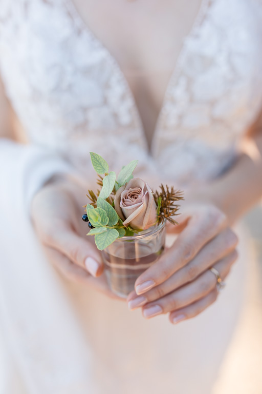 bride holding onto boutonniere