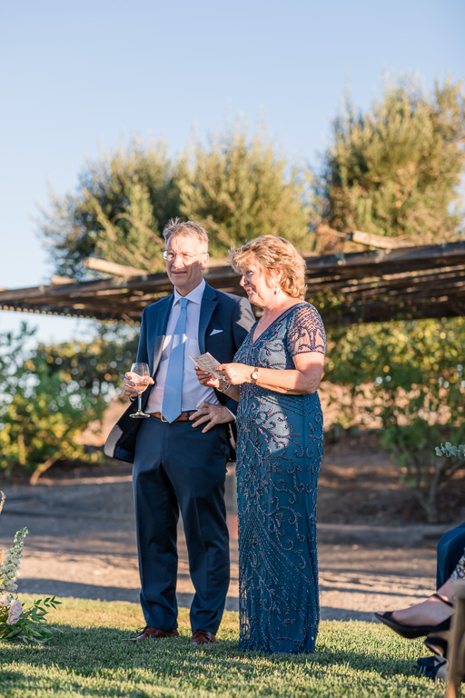 parents of the bride giving a speech during ceremony