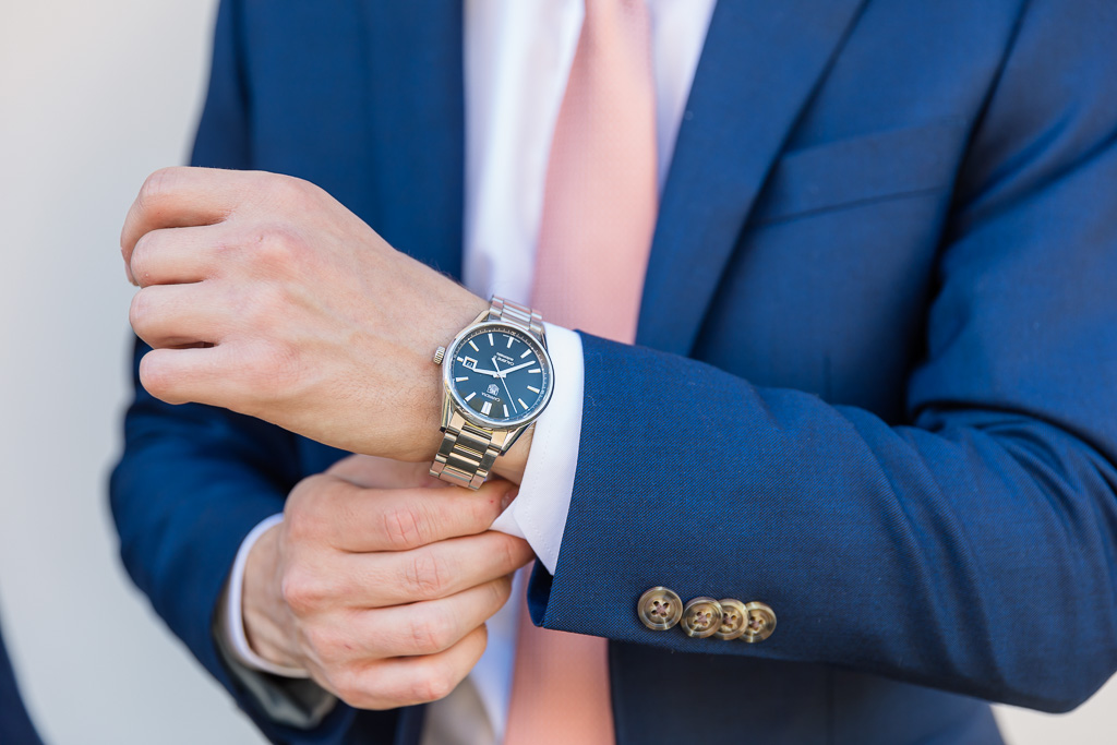 detail photo of groom's watch and hands