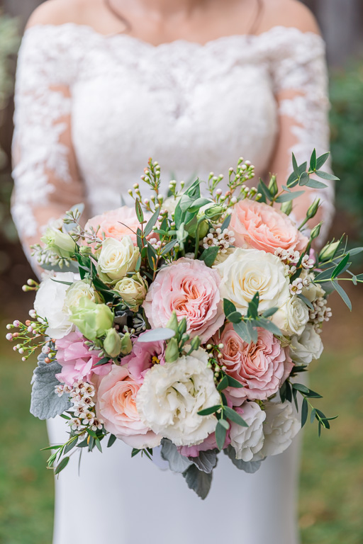 pastel colored bride bouquet for backyard wedding