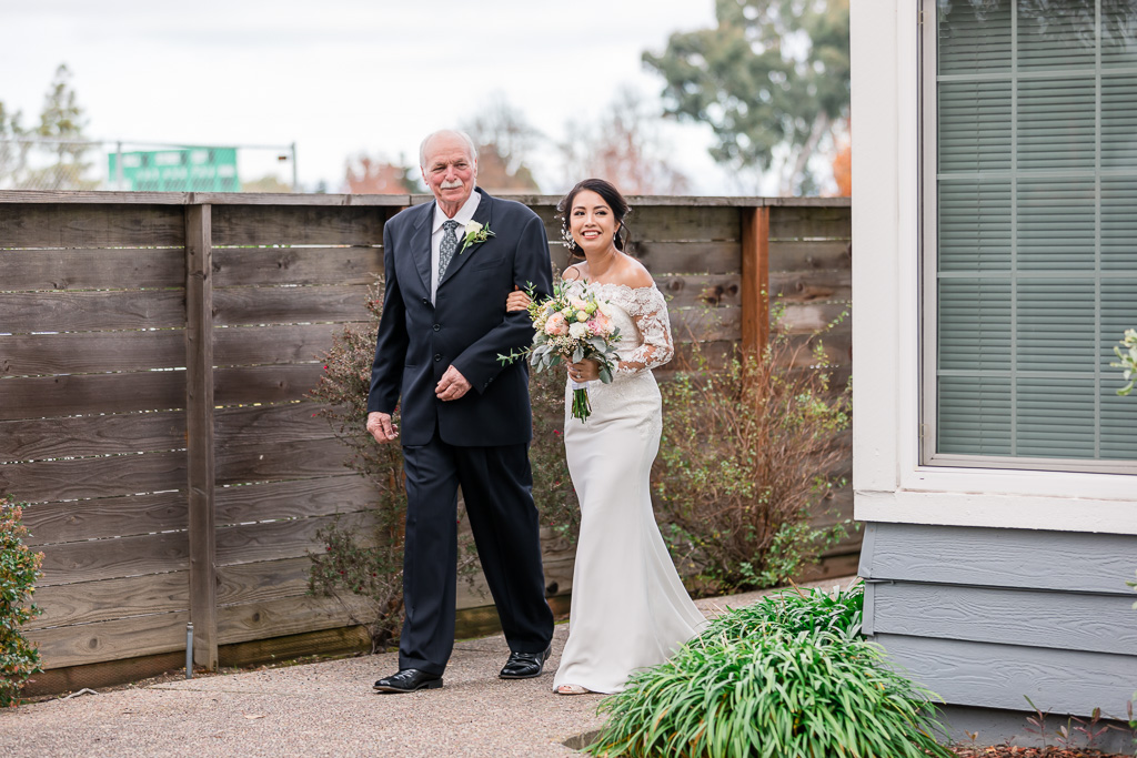 bride and father walking out for backyard wedding ceremony