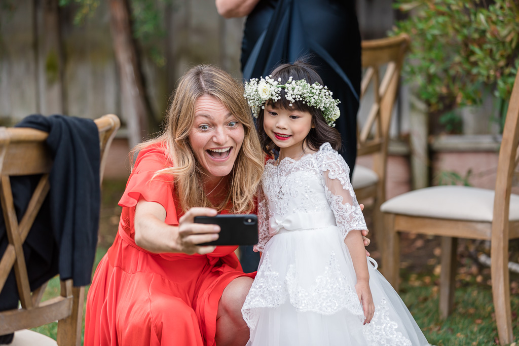 taking a selfie with the flower girl