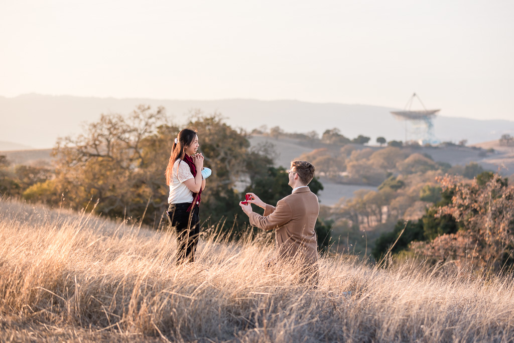a romantic surprise proposal at Stanford Dish trail
