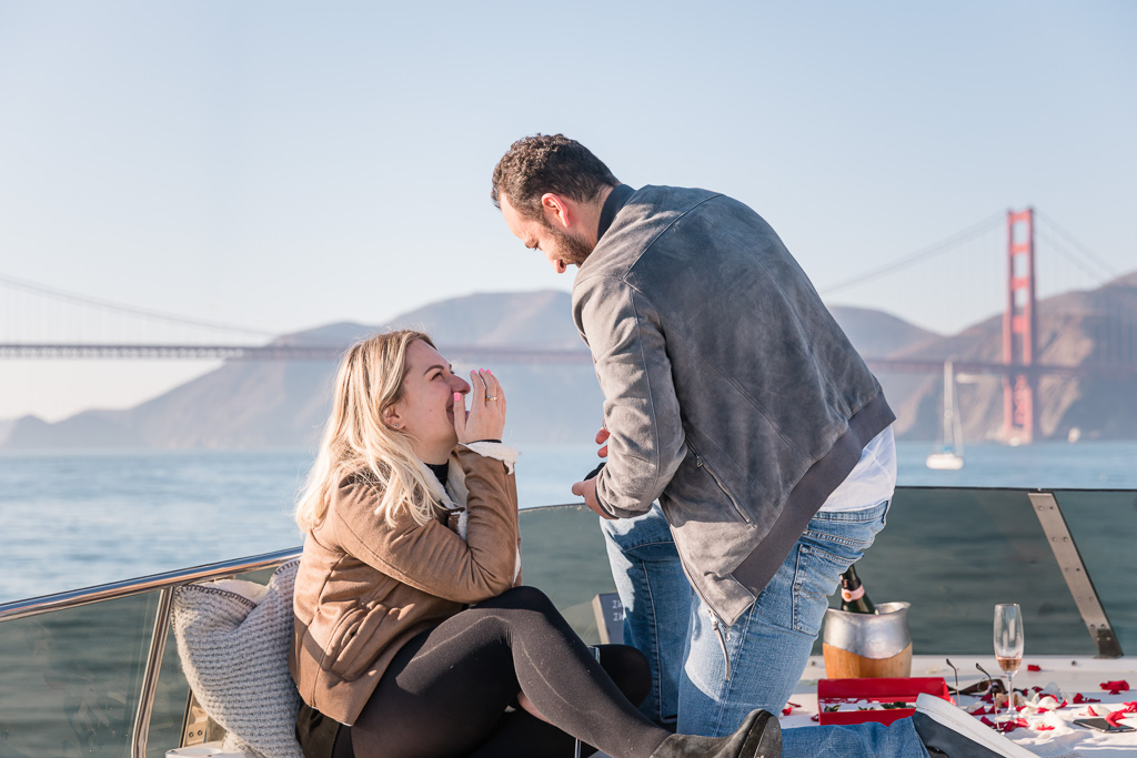 surprise proposal on a yacht in front of the Golden Gate Bridge