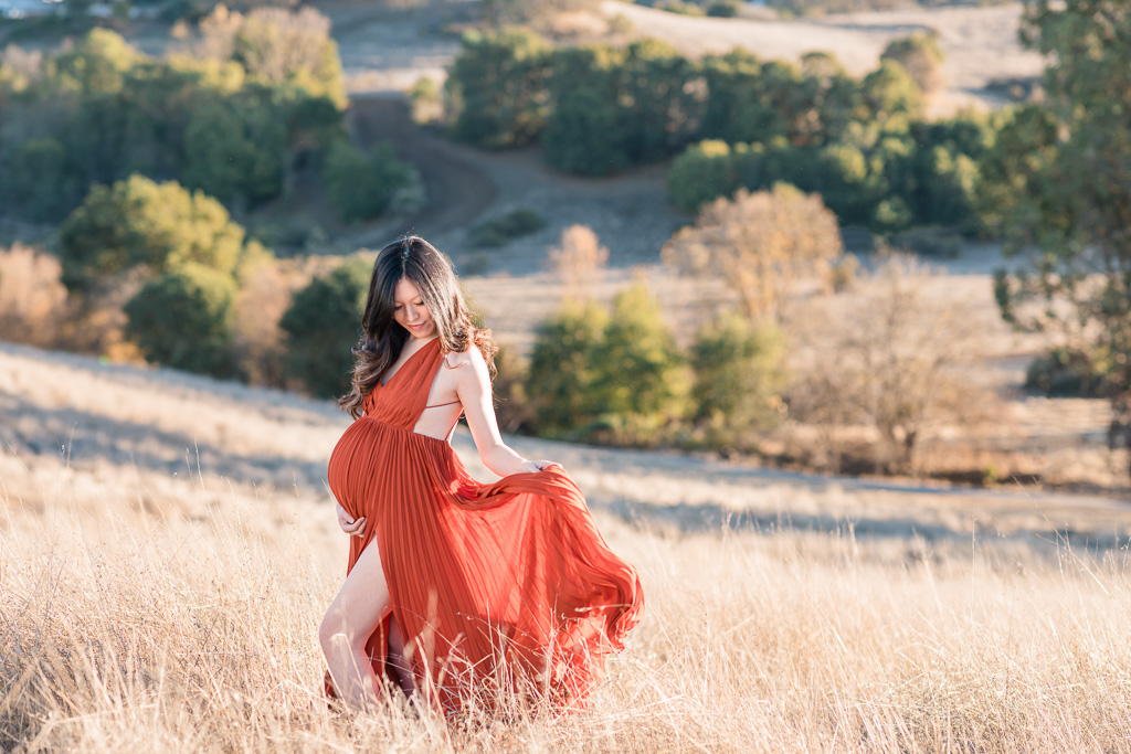 golden hour maternity photos with a sheer dress