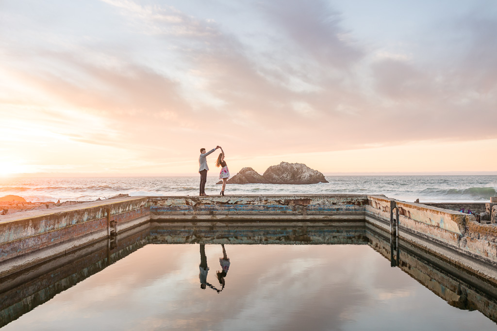amazing colorful winter sunset engagement photo at Sutro Baths