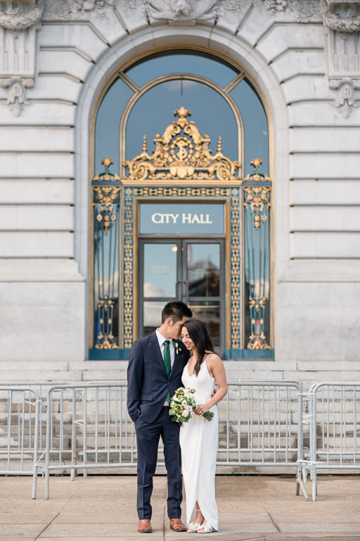 bridal portrait in front of San Francisco City Hall main entrance