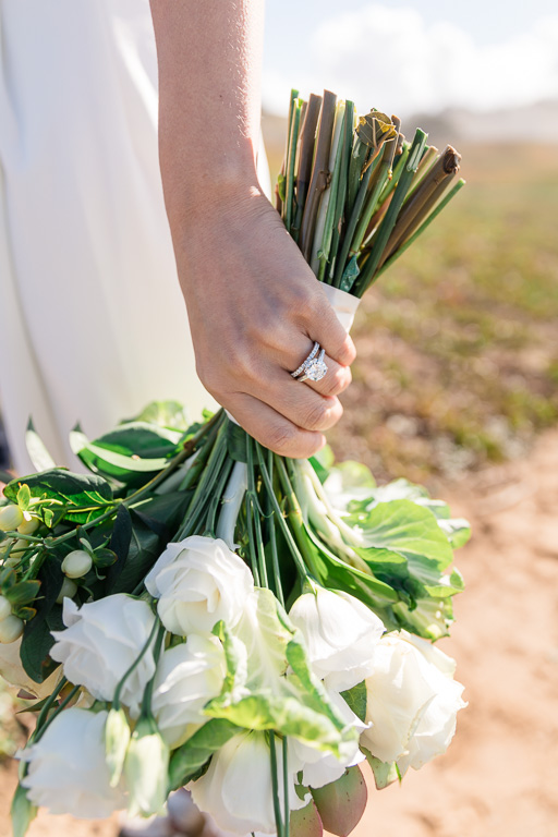 close-up photo of wedding ring and bouquet
