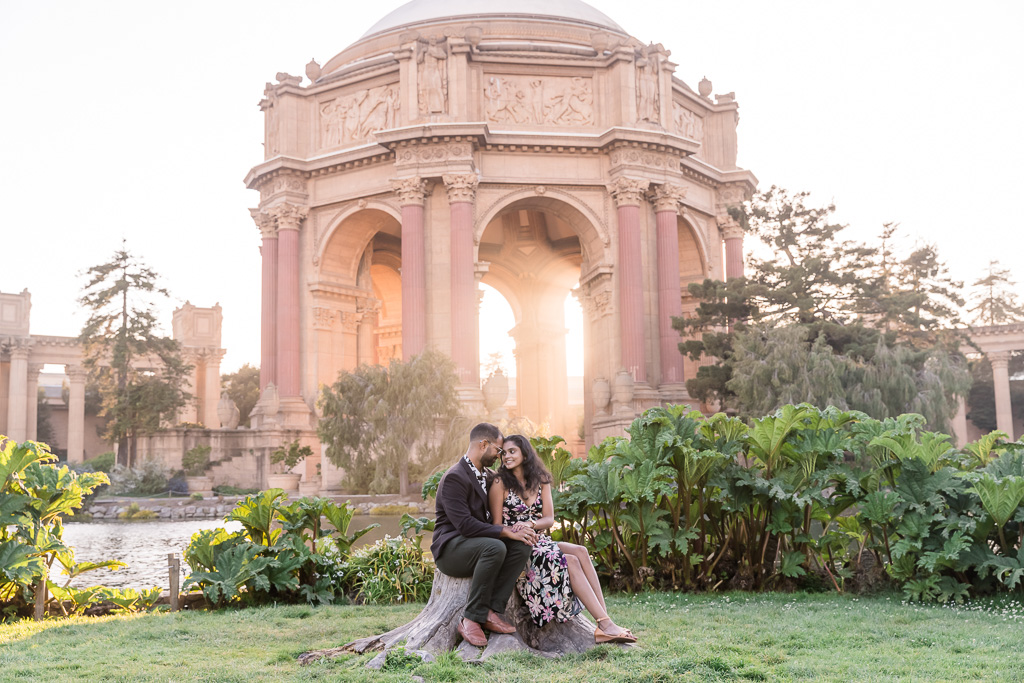 couple portrait in front of a glowing golden Palace of Fine Arts