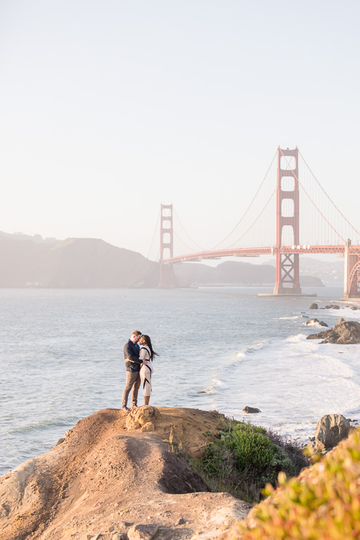 kissing in front of the bridge