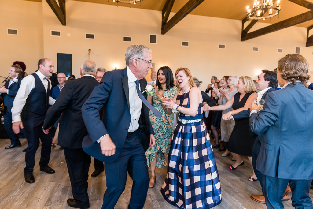 groom's parents dancing and partying at wedding