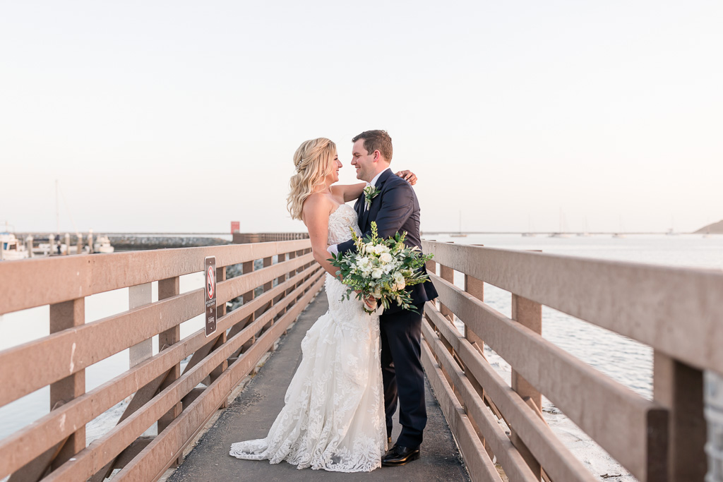 bride and groom on the pier in Half Moon Bay