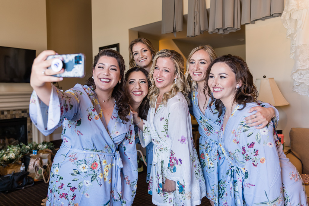 bride and bridesmaids taking a selfie