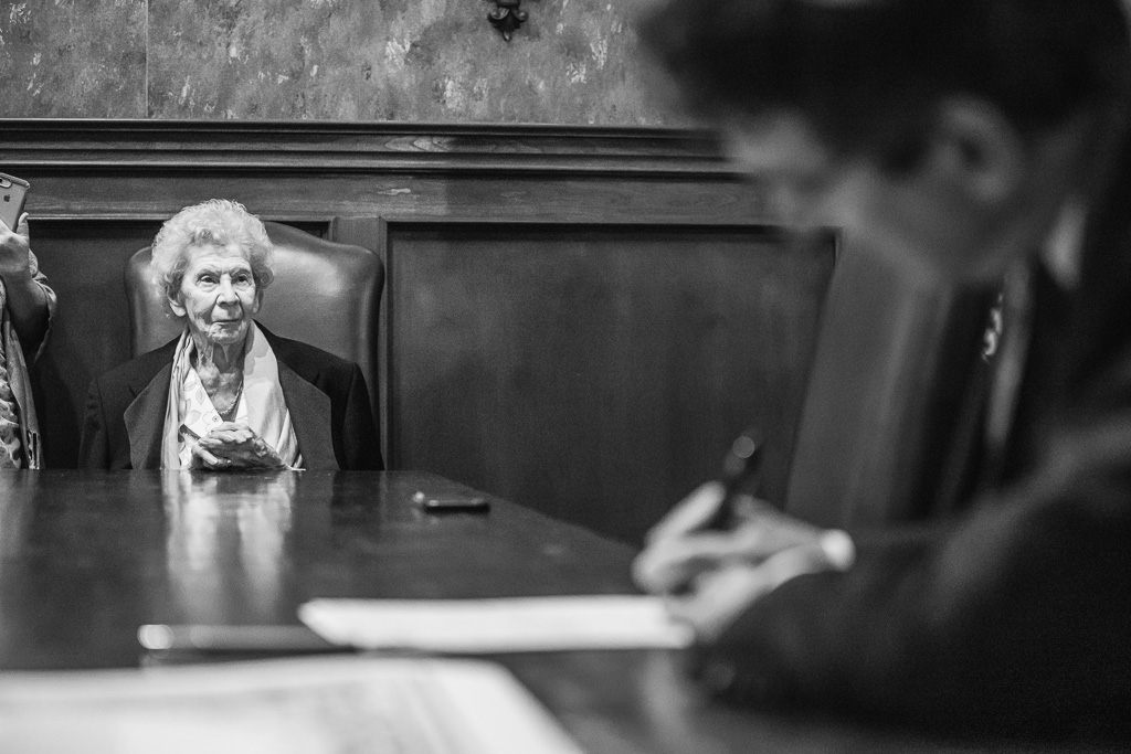 grandma witnessing marriage license signing