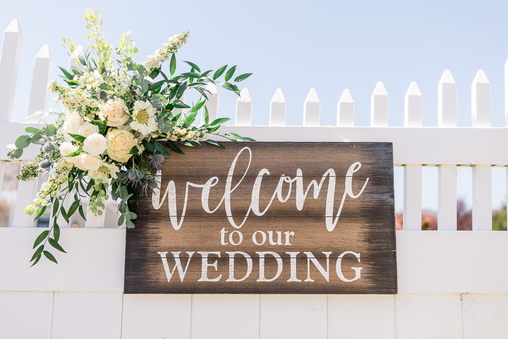 wooden welcome to our wedding sign