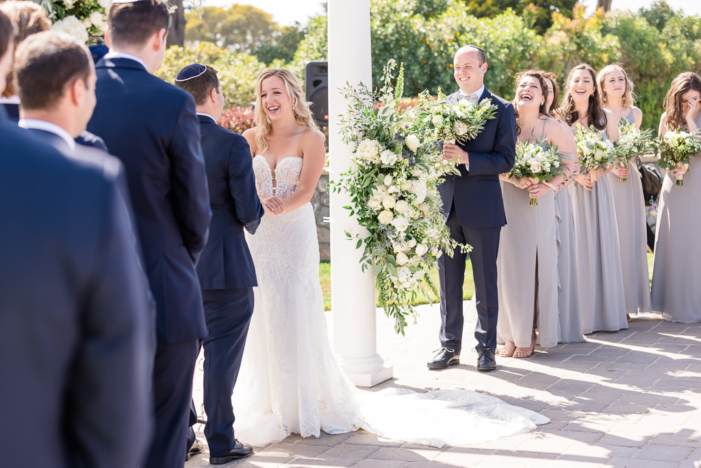laughing at funny moment during wedding ceremony