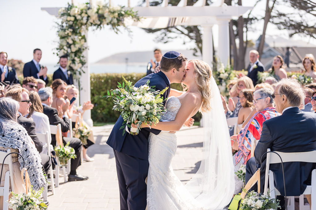 a second kiss in the aisle after the wedding ceremony