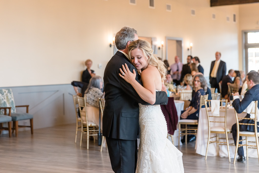 bride sharing a moment with father after father/daughter dance