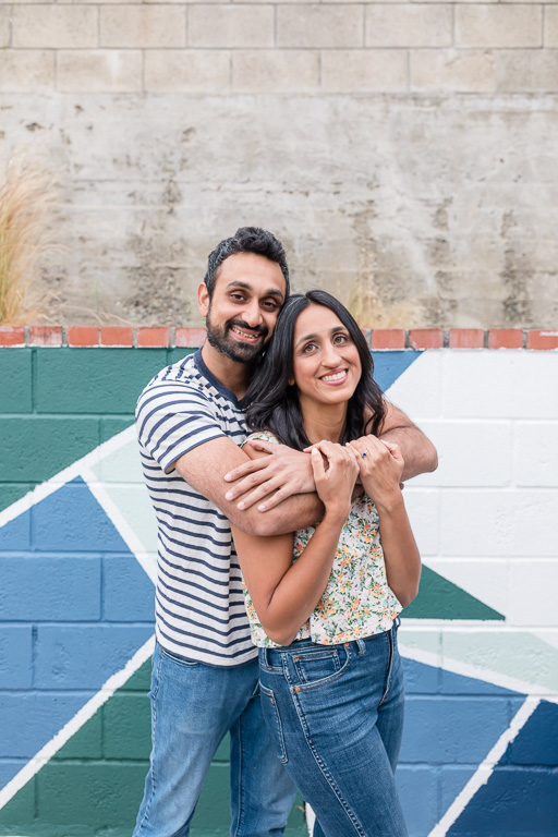 engagement photos in front of painted wall