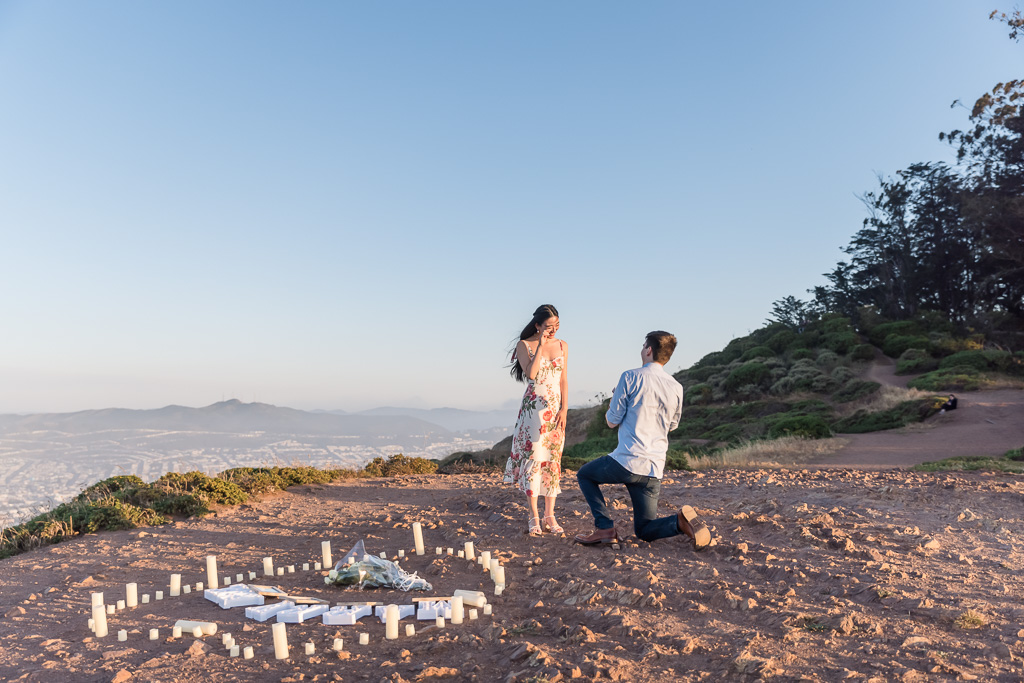 surprise proposal at a San Francisco mountain with a heart-shaped candle setup