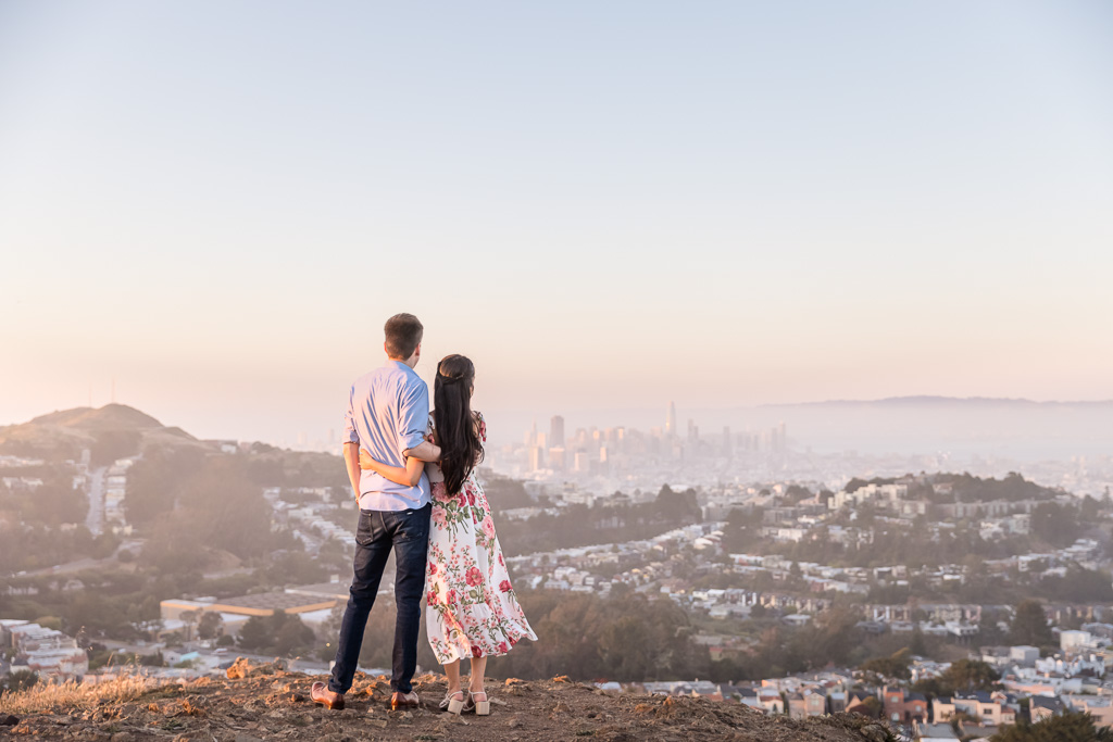 couple looking out over San Francisco during sunset