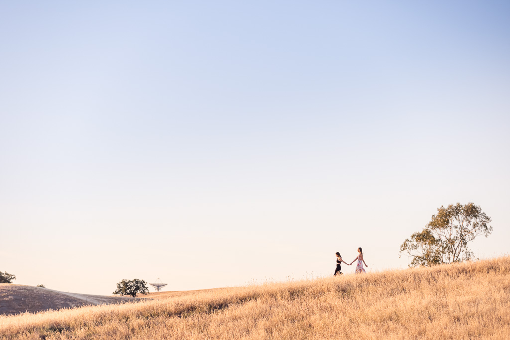 couple walking in front of Stanford Dish