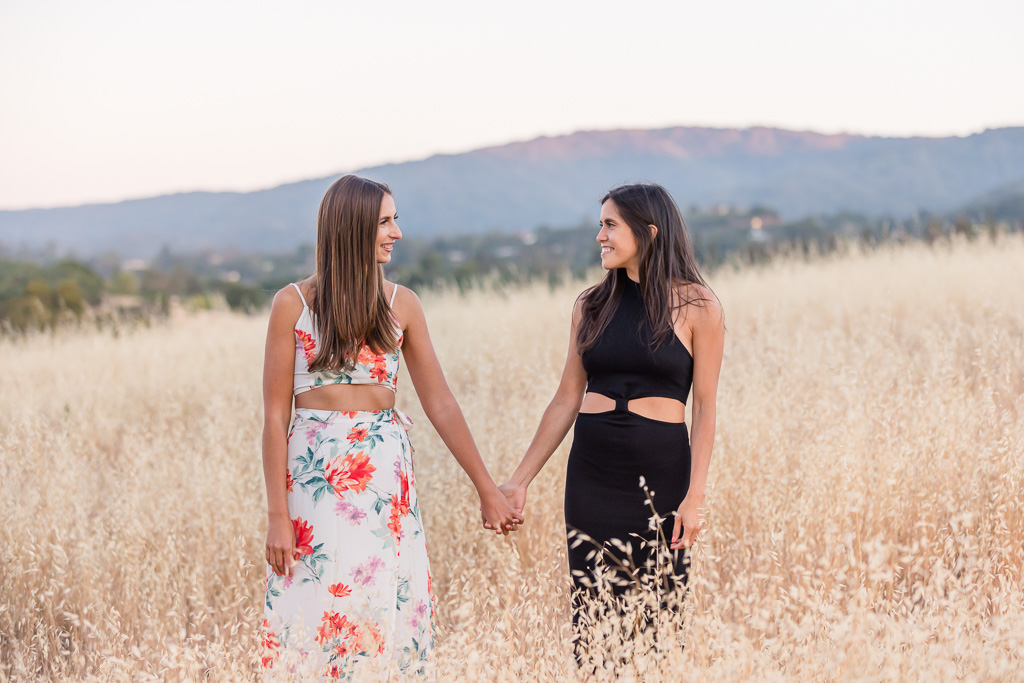 floral dress and black dress in engagement photos