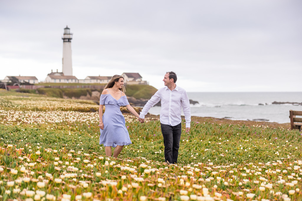 engagement photo at Pigeon Point Lighthouse wildflower field
