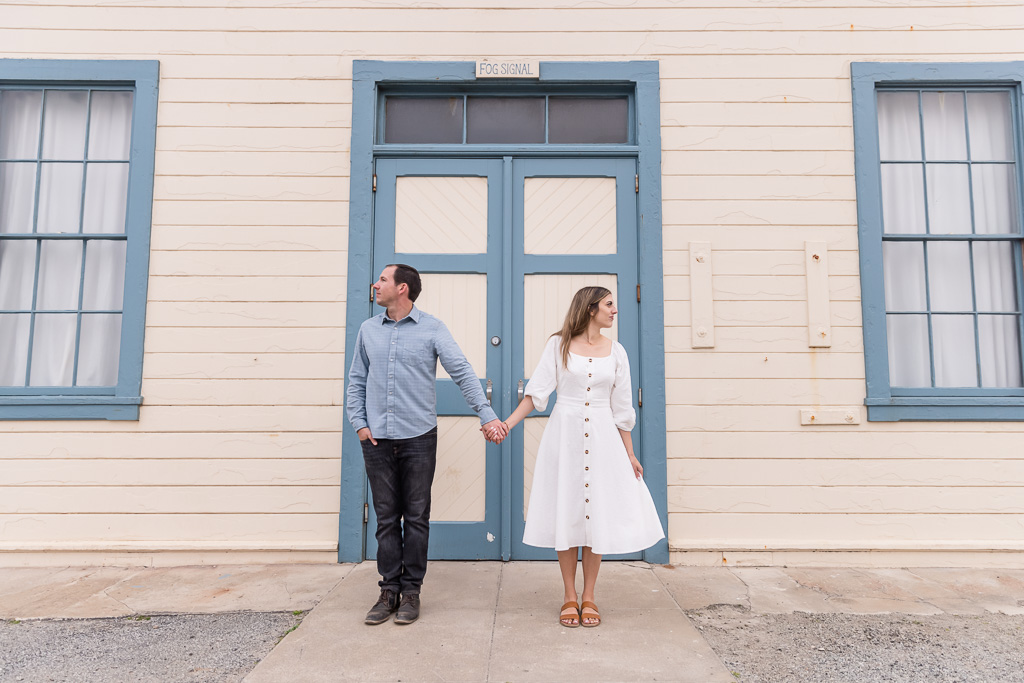 save-the-date picture in font of the iconic door