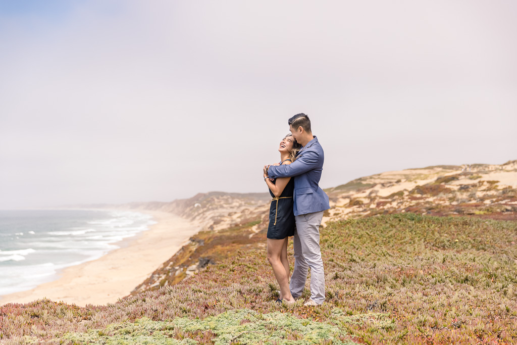 couple looking out over the cliffs of the California coast