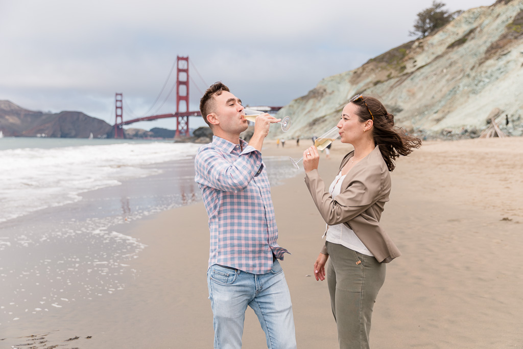 couple sharing a glass of champagne at the Golden Gate Bridge view
