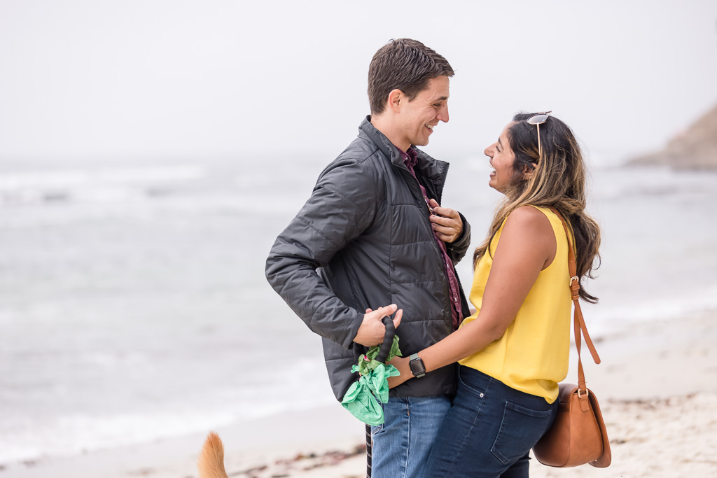 newly engaged couple on beach at Half Moon Bay