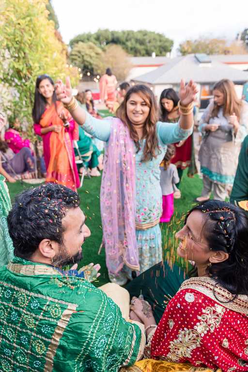 scattering rice on bride and groom for Indian blessing ceremony