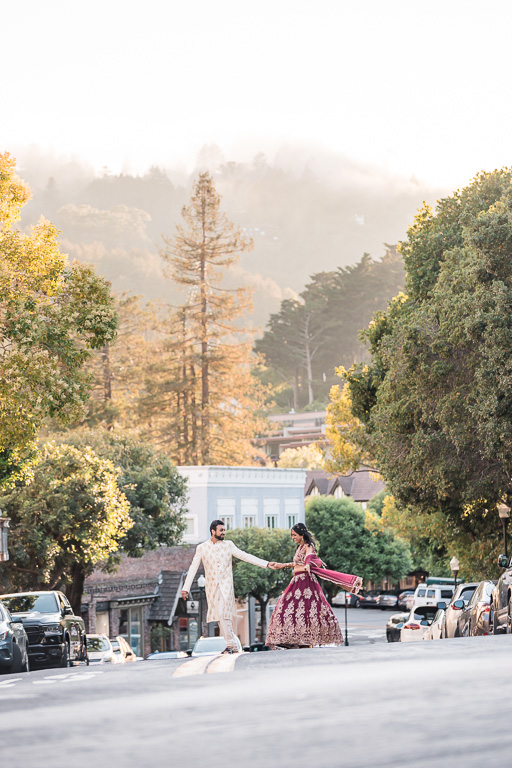 bride and groom crossing the street in Mill Valley at sunset
