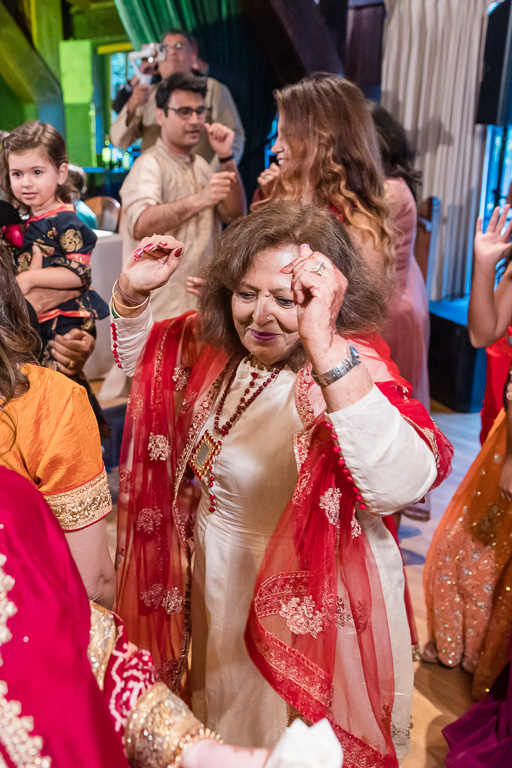an auntie dancing during wedding reception