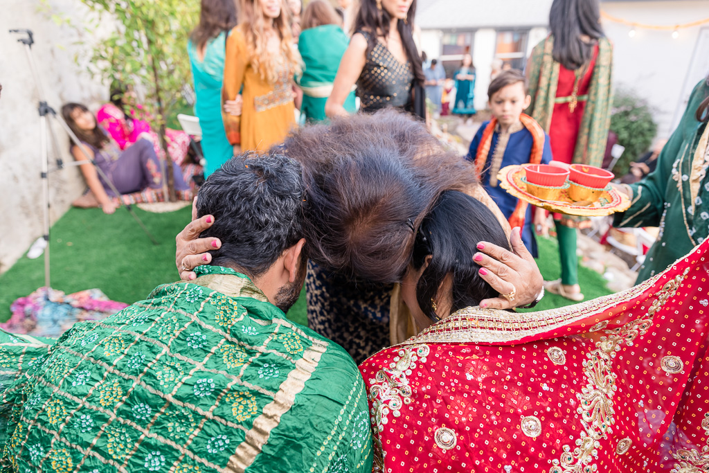 giving blessing during mehndi ceremony