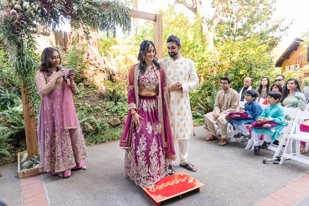 bride and groom stepping on seven piles of rice during Hindu ceremony at Outdoor Art Club