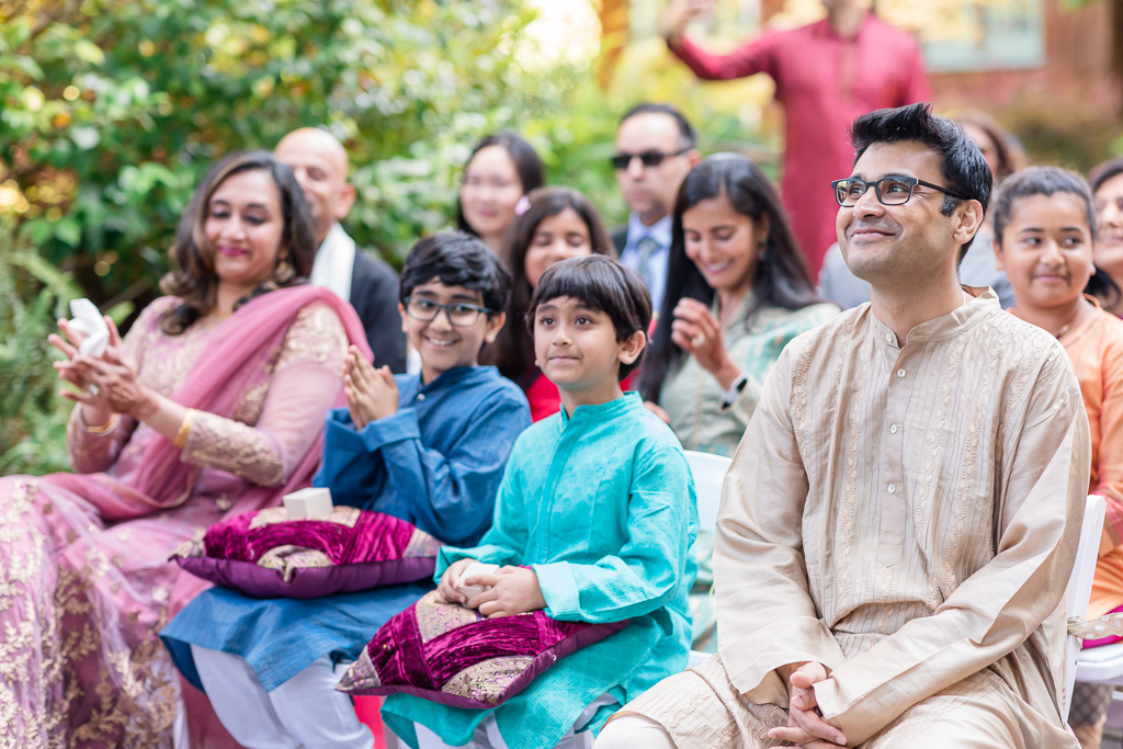 family in the first row during wedding
