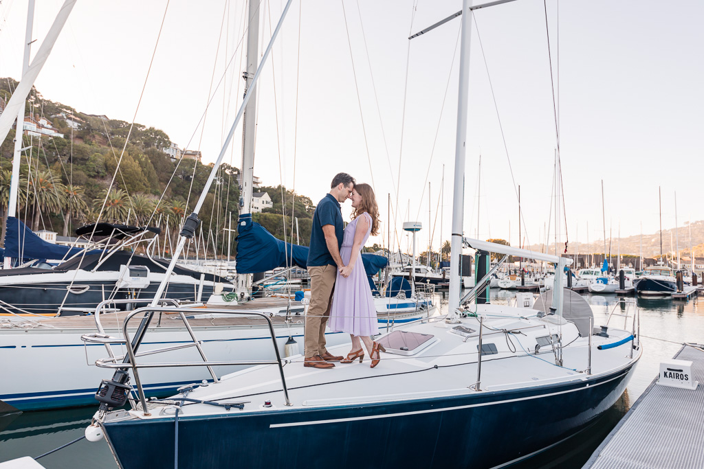 engagement photos on a boat in the marina