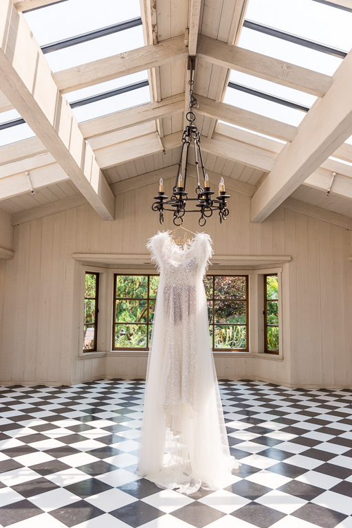 reception gown with a feather cape