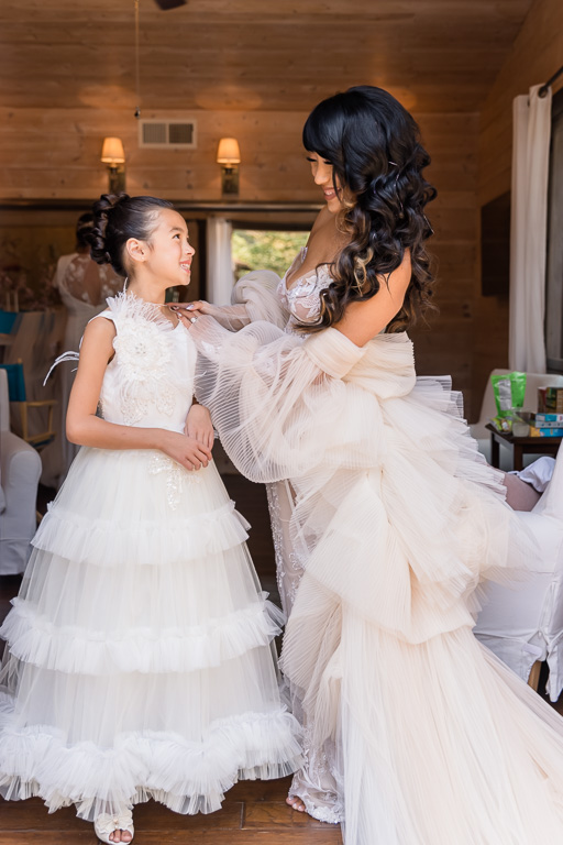 bride with her cute flower girl