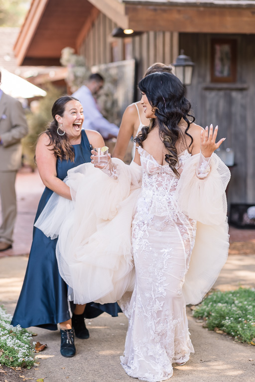 bride sneaking away with a drink in her hand