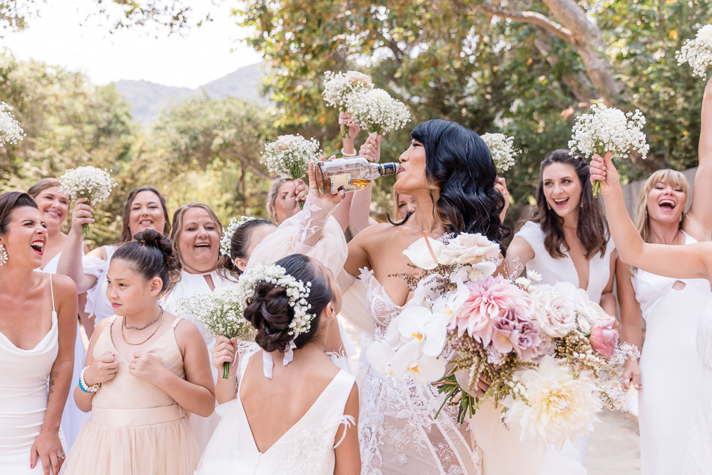 bride drinking whiskey with her girls