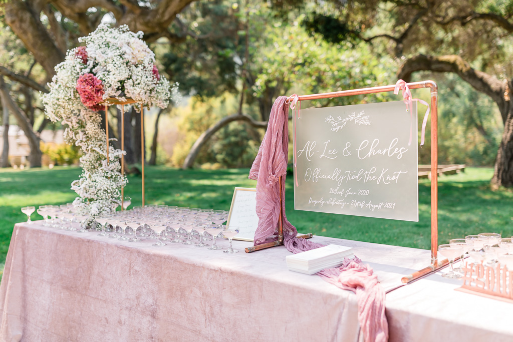 blush themed wedding sign-in table
