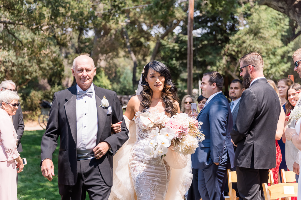 bride got emotional when walking down the aisle with her father